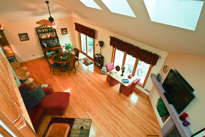 overlook to open family room from loft guest suite